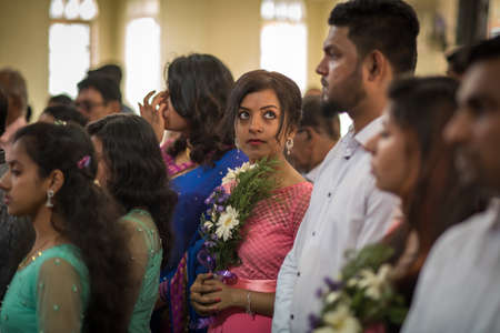 Kerala, India, 08-12-2017. Maid of honor at church. Catholic wedding in the Province of Kerala in South India. Religious celebration at church.