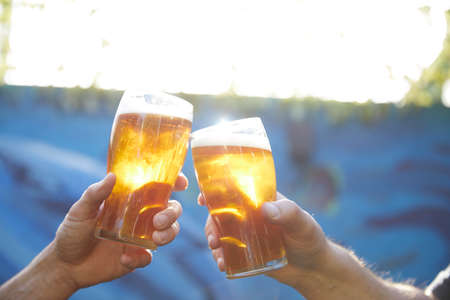 Toasting with beers.