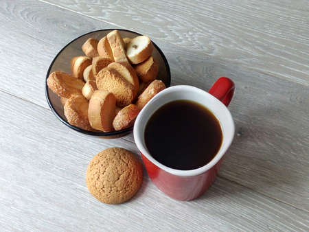 A cup of coffee with a biscuit on an early sunny morning before work or on the weekend is a wonderful charge of cheerfulness and a good positive start to the day