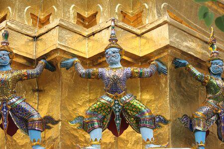 pra: The colorful giant statues carrying the pagoda at Wat Pra Kaeo, Bangkok