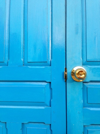 colo: The bright blue door with golden color knob
