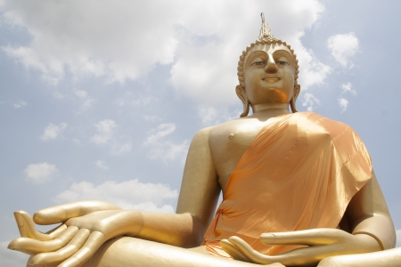 Big golden Buddha statue in blessing posture