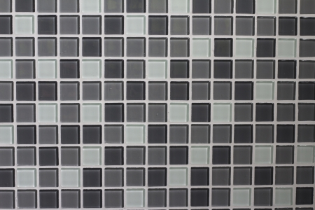 Wall decorated with grey colored glass mosaic photo