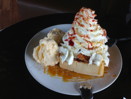 Ice cream and honey toast with whip cream and cinnamon photo