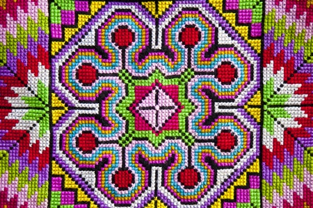 Colorful cross-stitch cloth background photo