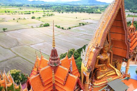 Big Buddha statue at Wat thum saue, Kanchanaburi, Thailand in top view photo