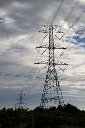 High voltage electric tower under the cloudy sky photo