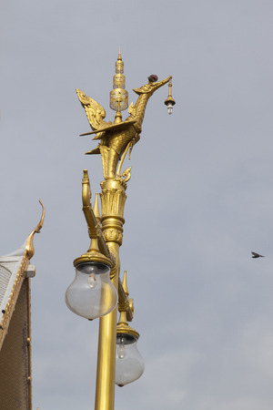 Lamp post with swan sculpture of Thailand photo