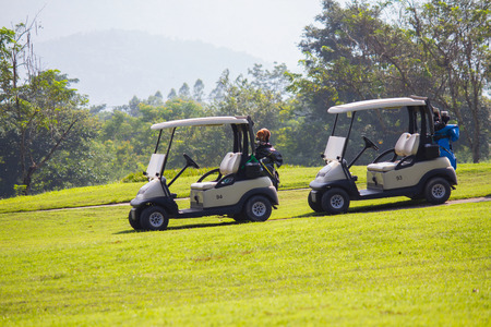 Golf carts parking on the green