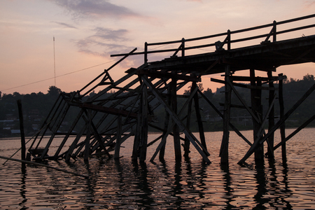 Broken Raman wooden bridge in Sangklaburi, Thailand photo
