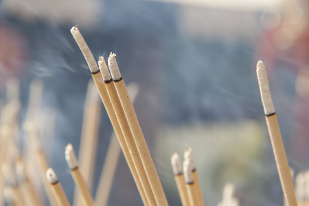 Lighted joss sticks in the temple, close-up Stock Photo - 25238752