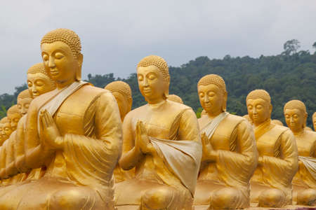 disciple: Golden disciple statues in the row