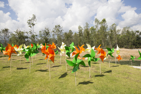 wind down: Colorful plastic wind wheel stabbed down on the ground Stock Photo