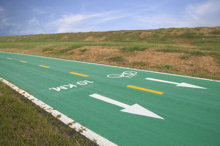 kilometre: Green bicycle track with sign at 10 Kilometre