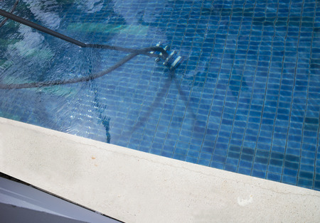 Vacuum cleaner in the swimming pool photo
