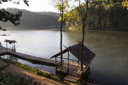 pang: Hut and wooden bridge on Pang Oung lake, Thailand Stock Photo