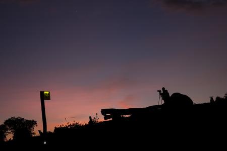 camera man: Camera man in view, silhouette