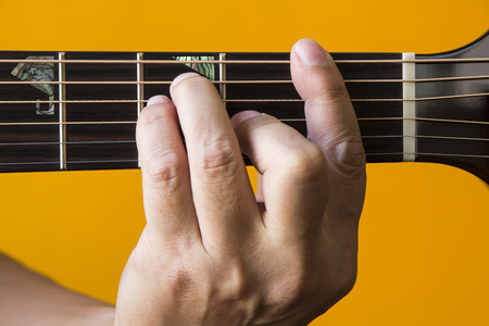 Hand Performing F Chord On Guitar Stock Photo Picture And Royalty