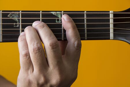 chord: Hand performing B chord on guitar Stock Photo