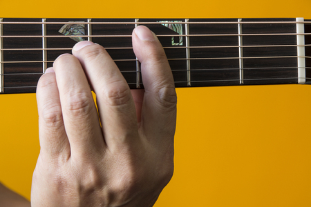 chord: Hand performing C chord on guitar Stock Photo