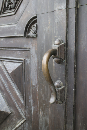 iron: The old wooden door with handle