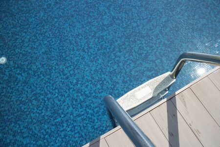 Poolside with the ladder and clear water