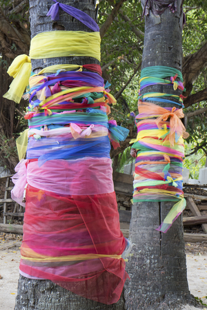 wood nymph: Colorful cloth tied around the tree to respect for wood nymph Stock Photo