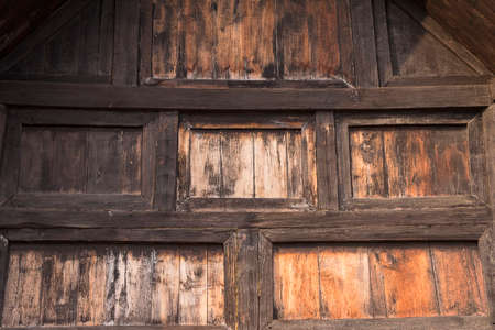 Old wooden wall of the ancient temple Stock Photo