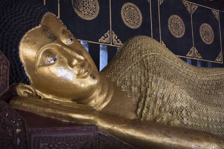 spiritual architecture: Reclining Buddha statue in the temple of chiangmai, Thailand Stock Photo