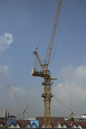 Yellow cranes in construction site in the city