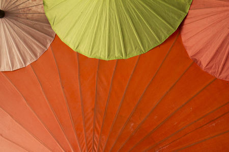 Colorful umbrella background, big and small ones Stock Photo
