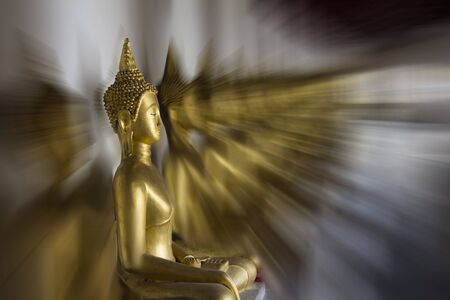 Row of golden Buddha statues with radial effect
