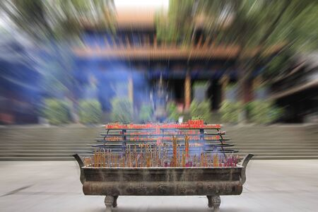 Big joss stick pot in front of the main hall of the temple, China with motion blurred effect Stock Photo