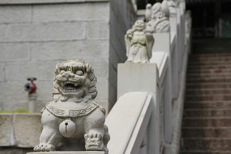 Chinese stone lion at the stairs of Guangde temple, China