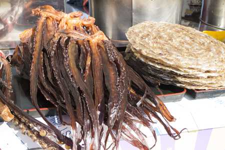 Flovored dried squid with big and long tentacle, street food in Korea Stock Photo