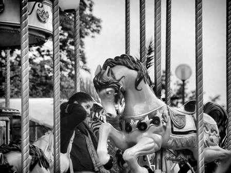 merry go round: Merry go round horse  in Monochrome Editorial
