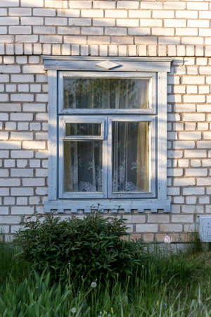 Window in the cottage. Window in a rural house. High quality photo 版權商用圖片