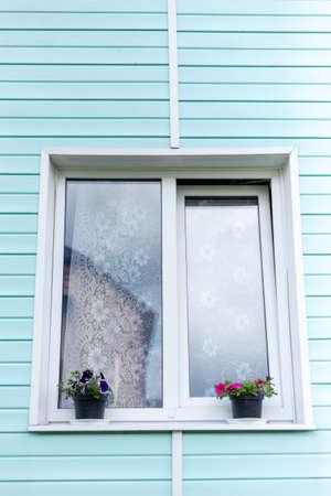 Window in the cottage. Window in a rural house. 版權商用圖片