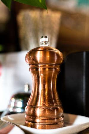 Brown metal pepper shaker. Bronze pepper shaker.