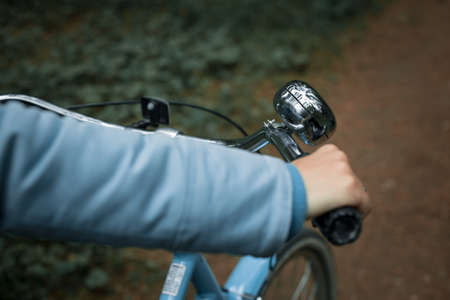 Womans hand on the handlebars of a bicycle