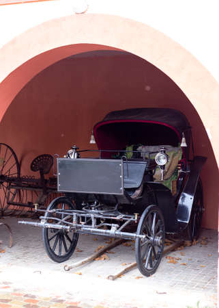 Old carriage near the pink house Banco de Imagens