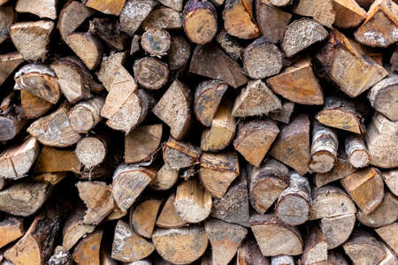 Chopped firewood stacked together. Fuel.