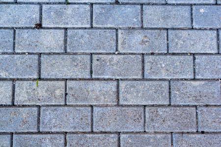 Gray paving slabs brick on the road Stockfoto