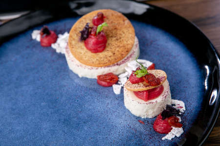 Yogurt and white chocolate mousse with raspberry cream. French cuisine. The work of a professional chef. Dish from a restaurant or cafe menu. Close-up.