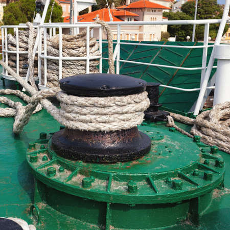 winch: rope winch with thick rope during mooring on larger passenger ship