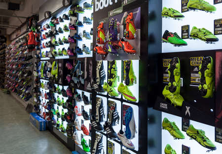 soccer shoes: LJUBLJANA, SLOVENIA - SEPTEMBER 18, 2015: Photo shows a soccer shoes display wall at the SPORT 2000 store. In the picture are mainly shown the Adidas, Puma and Nike examples.