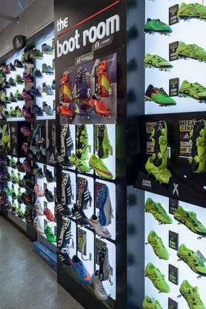 soccer shoes: LJUBLJANA, SLOVENIA - SEPTEMBER 18, 2015: Photo shows a soccer shoes display wall at the SPORT 2000 store. In the picture are mainly shown the Adidas and Puma examples.
