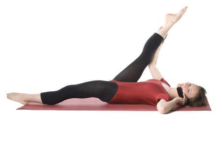 Exercising woman talking on cellphone, studio shot photo