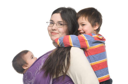 Woman carrying her little daughter in a sling. Her son hugging her from behind photo
