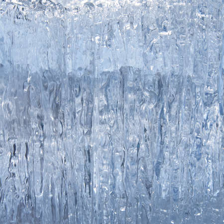 icicle: Block of blue smooth melting ice, close-up